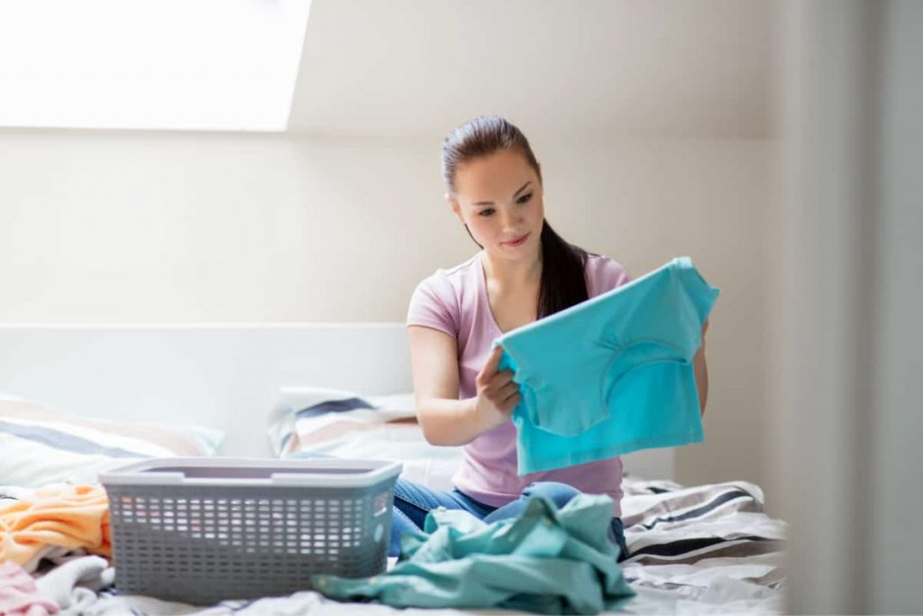 woman sorting laundry at home