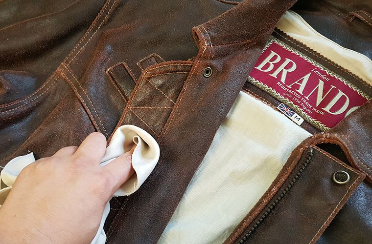 Spot cleaning a brown leather jacket