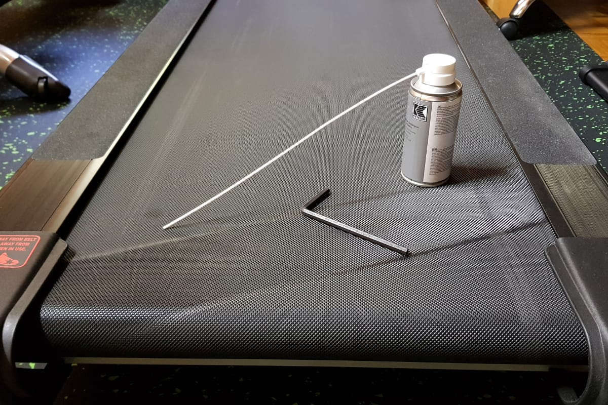 Treadmill belt with a can of lubricant on it
