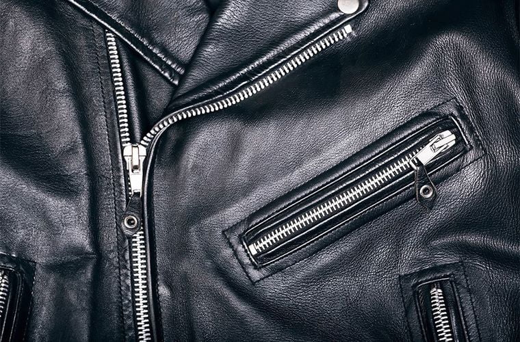 close up of a black leather jacket with zippers