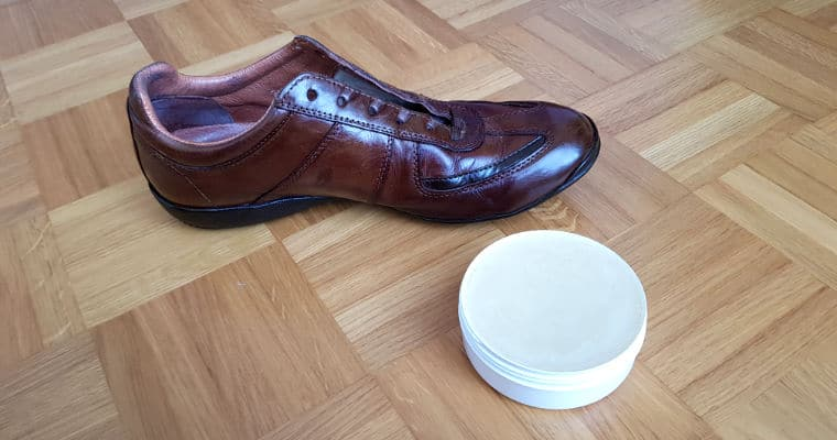 brown leather shoe with a conditioner
