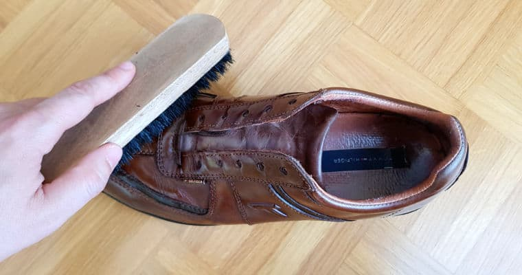 brushing a brown leather shoe 2