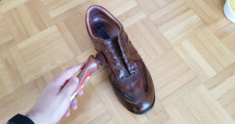 conditioning a brown leather shoe