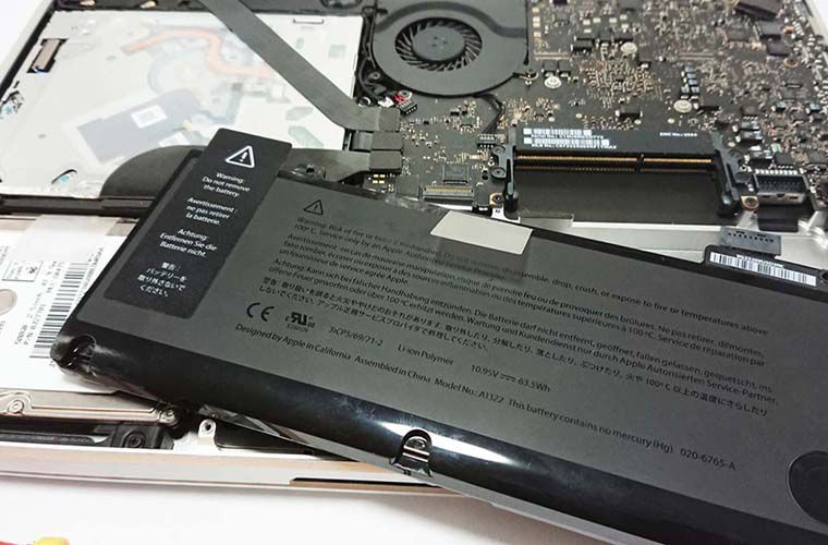 macbook with a removed cover and battery