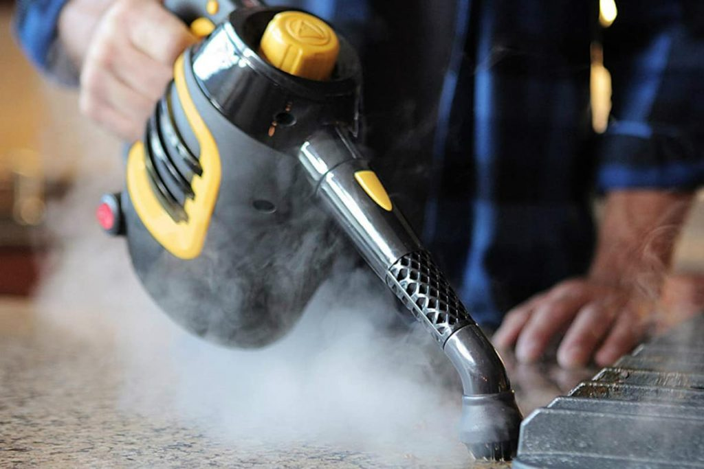 steam cleaning the kitchen counter top with a handheld steam cleaner