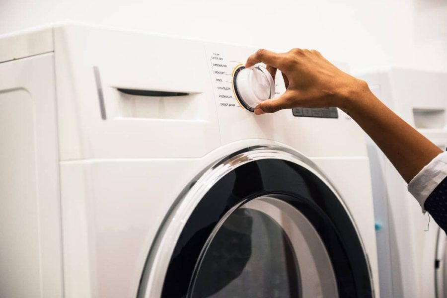 a woman setting up the washing machine
