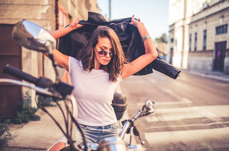 young woman on a motorcycle wearing a t-shirt
