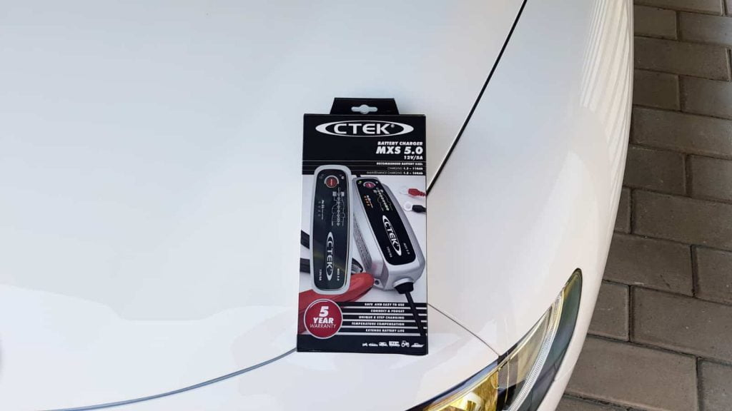 CTEK MXS 5.0 on the hood of white Alfa Romeo Stelvio (MY2019)