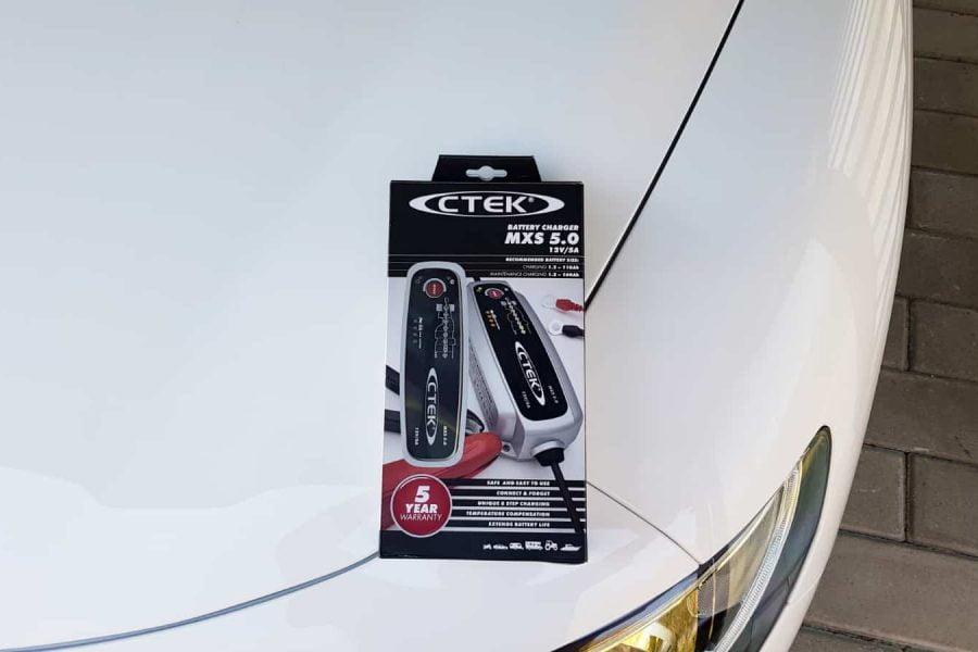 CTEK MXS 5.0 on the hood of white Alfa Romeo Stelvio (MY2019)