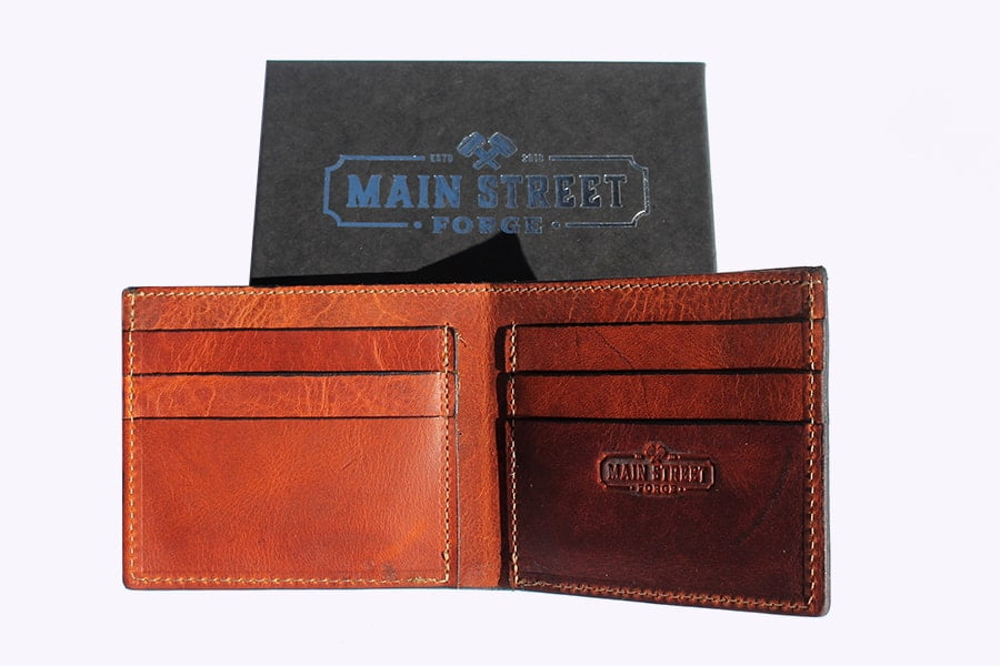 Main Street Forge Leather Bifold Wallet (Tobacco snakebite brown) and the box