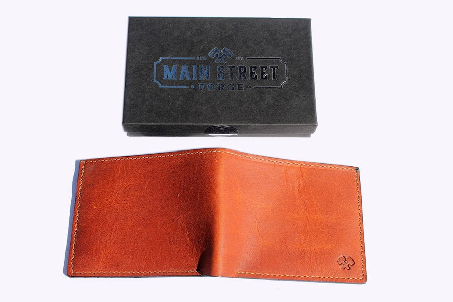 The back of Main Street Forge Leather Bifold Wallet (Tobacco snakebite brown)
