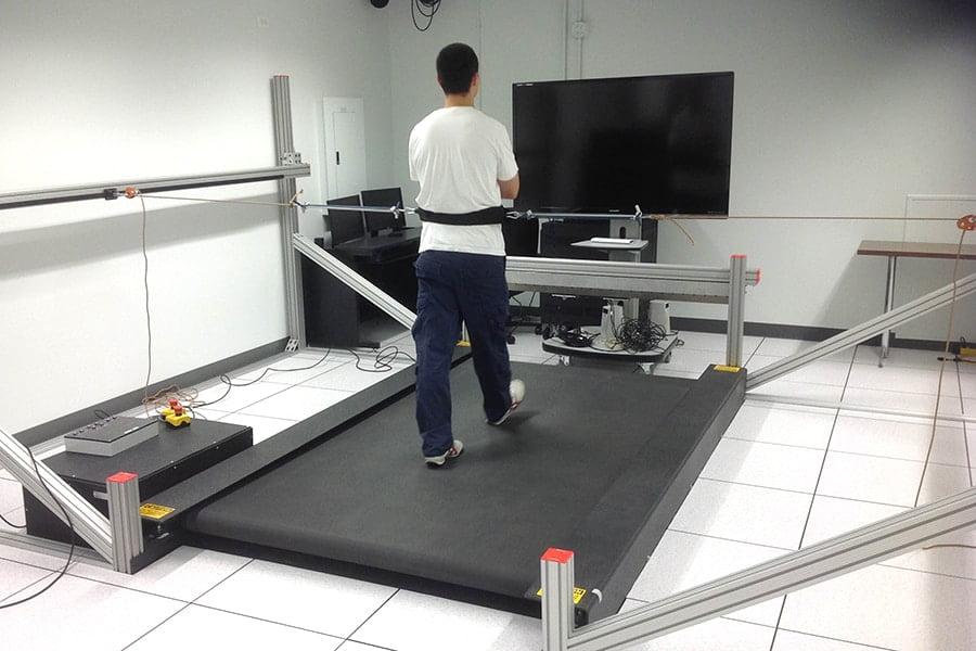 Man walking on a custom built Tuff Tread treadmill