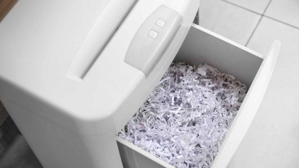 Document shredder with paper shreds - closeup