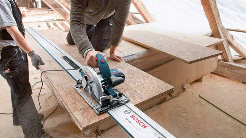 man using bosch gsk 65 g circular saw