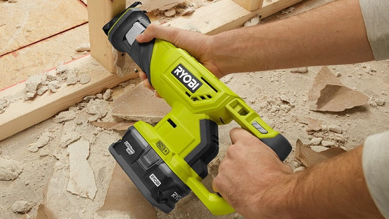 man working with ryobi 18v one plus reciprocating saw