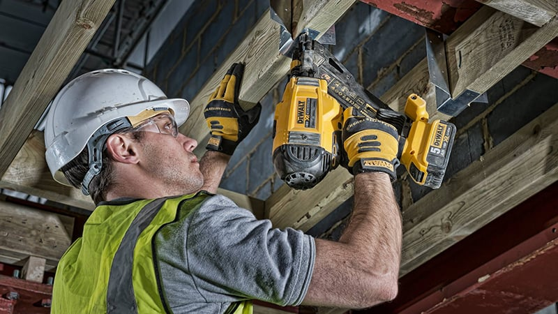 worker using a dewalt 18v xr brushless nailer