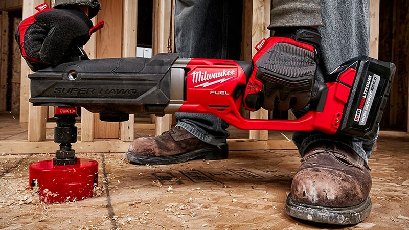 worker using a milwaukee m18 fulel super hawg drill