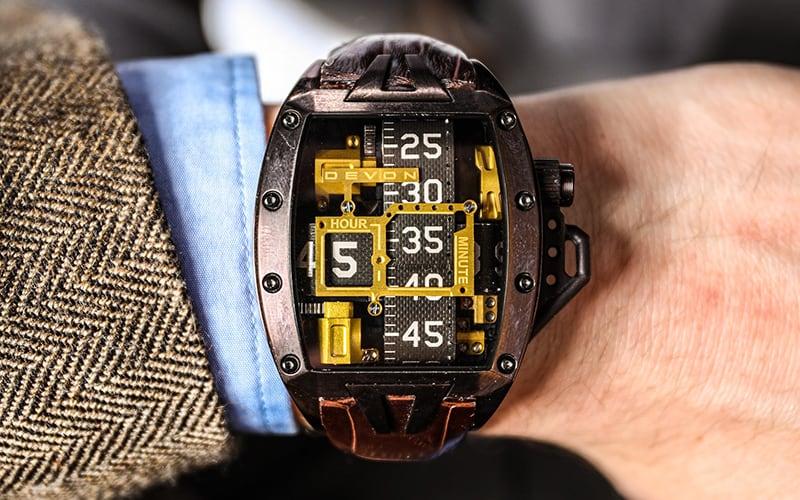 man's wrist with a devon works watch